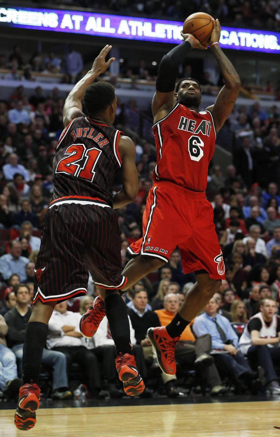 James y la defensa dan a los Heat su noveno triunfo seguido
