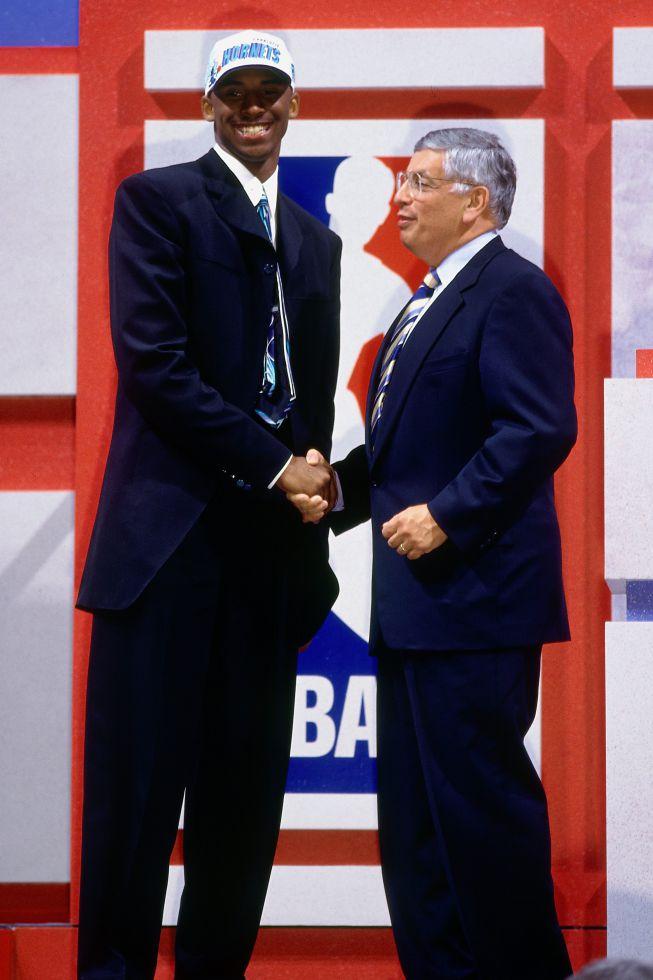Junto a David Stern, tras ser elegido en el número 13 del draft de 1996 por los Charlotte Hornets. Poco después fue traspasado a los Lakers a cambio de Vlade Divac.
