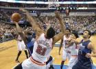 Wade (18) y Bosh (20) baten a Nowitzki (28) en Dallas