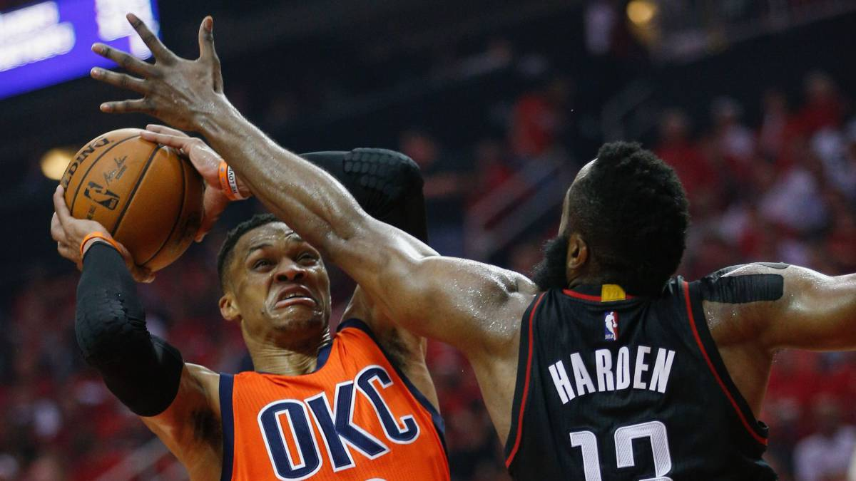 Russell Westbrook battles with James Harden.