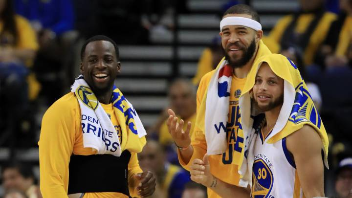 Draymond Green, JaVale McGee y Stephen Curry.