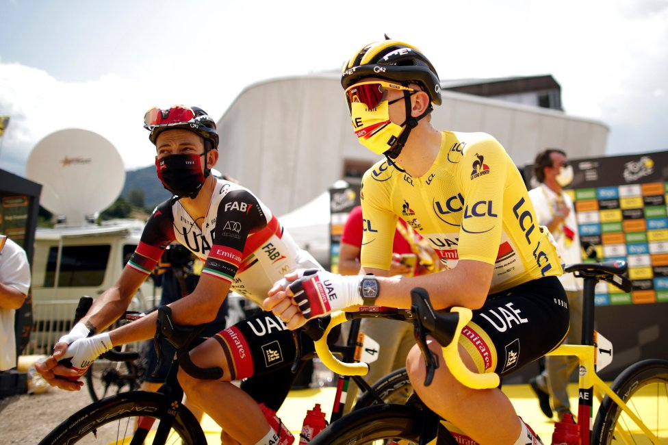 Team Emirates rider Tadej Pogacar of Slovenia wearing the overall leader's yellow jersey with UAE Team Emirates rider Davide Formolo of Italy before the start of stage 10