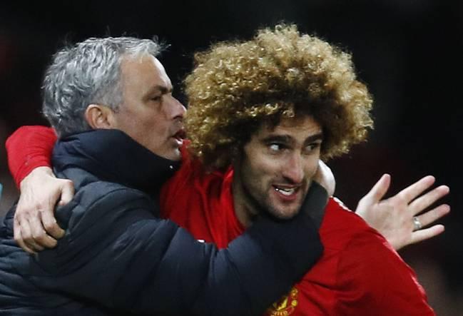United's Marouane Fellaini celebrates scoring with manager Jose Mourinho.