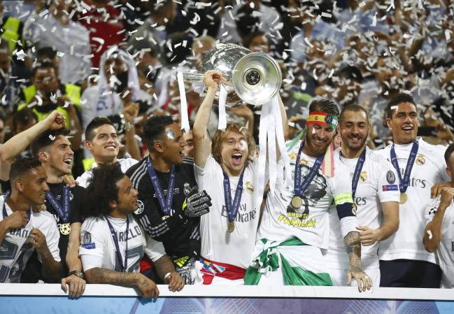 Real Madrid's Luka Modric lifts the trophy as they celebrate winning the UEFA Champions League