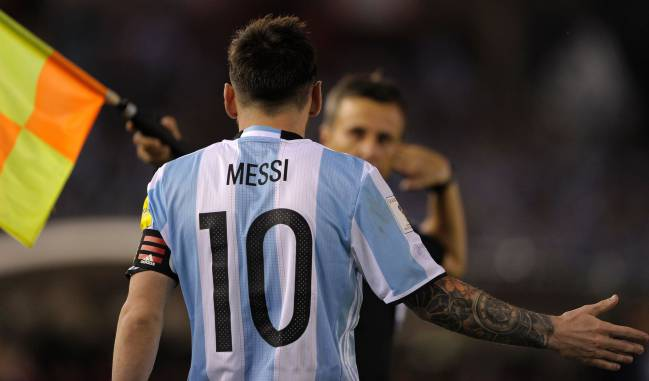 Messi having a word with the assistant during the game against Chile.