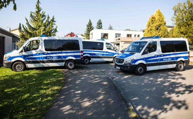Police cars are seen in Rottenburg am Neckar, on April 21, 2017 following an arrest of a German-Russian man in connection with the bomb attack on Dortmund's team bus.