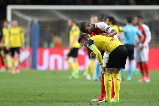 Monaco's Almamy Toure comforts Dortmund's Marco Reus after the UEFA Champions League quarter-final but the story could have been much worse.