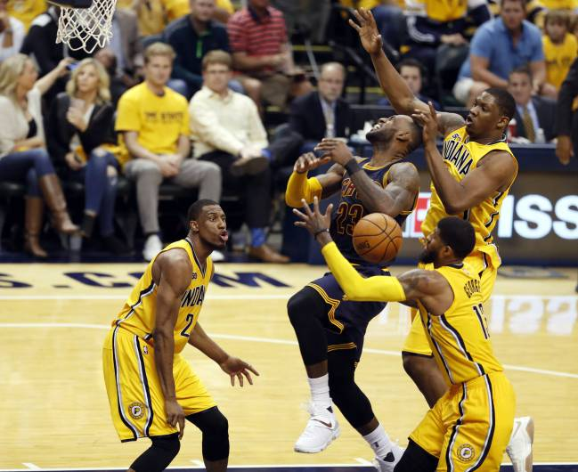 Cleveland Cavaliers forward LeBron James (23) gets fouled going up for a shot against Indiana Pacers forwards Thaddeus Young