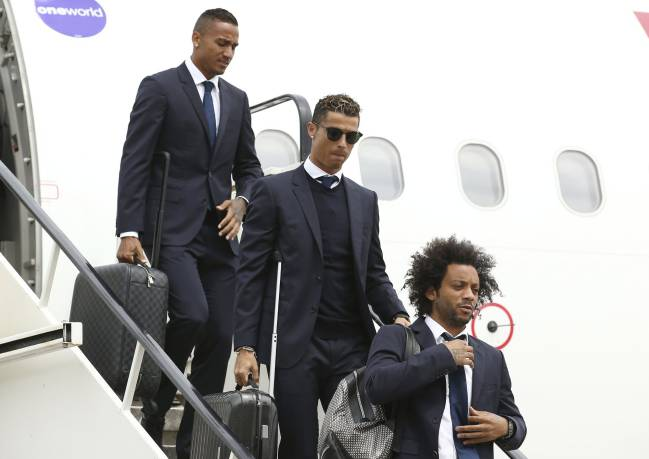 Real Madrid's players get off the plan in Cardiff as they arrive for the Champions League final.