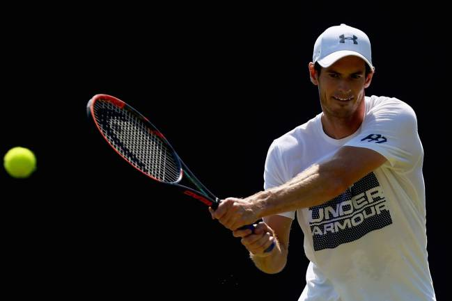 As he prepares for Wimbledon, Andy Murray has hit back at John McEnroe's claim that the Scot should be viewed as way behind Federer, Nadal, and Djokovic.