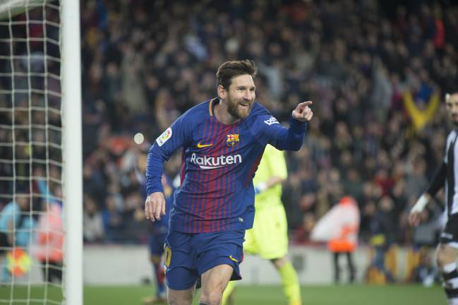 Barca romps with Messi magic show