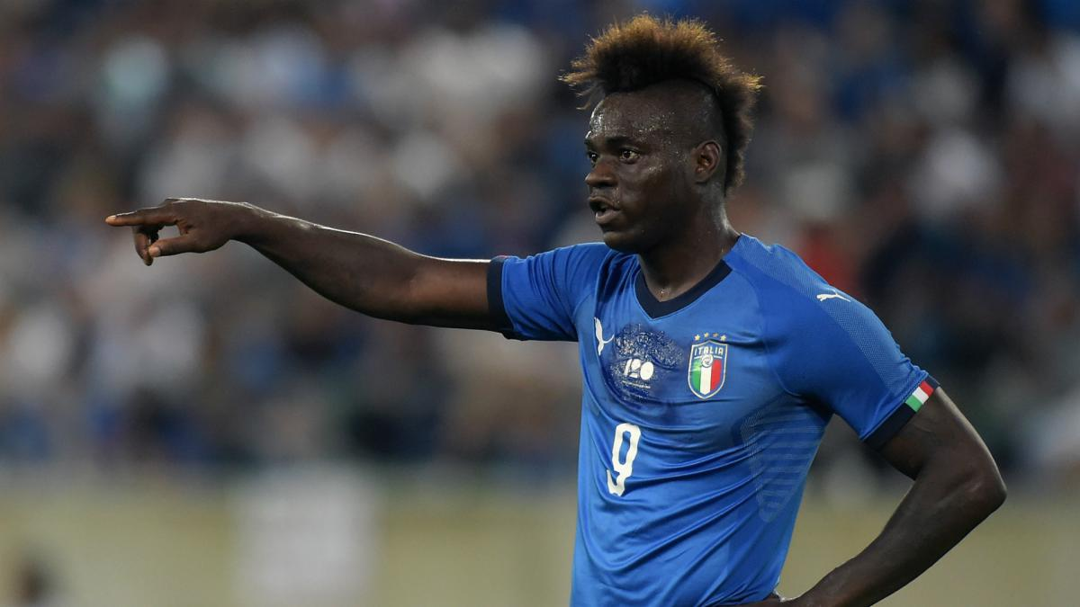 Balotelli helps Italy to victory on return