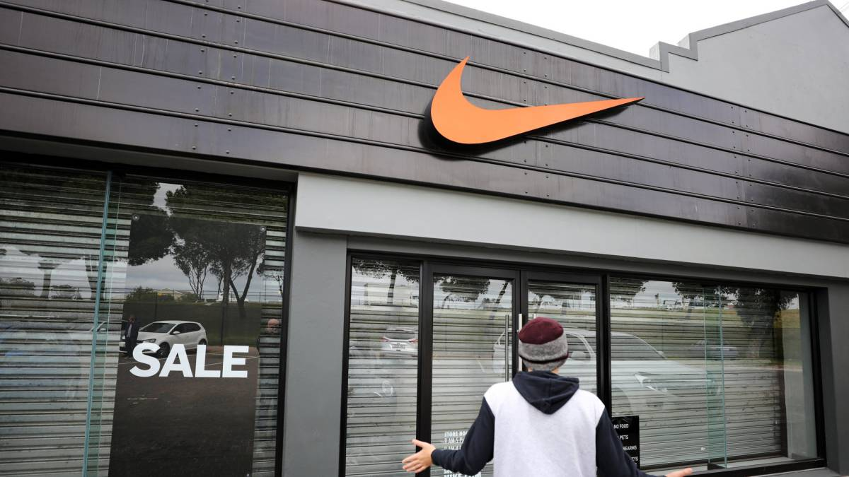 sale retailer 6755e 00edf A man gives a photo-friendly reaction as he finds a Nike store closed in