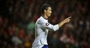 Cristiano da la victoria a Portugal y Alemania empata
