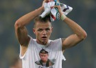 UEFA expedienta a Tarasov por su camiseta ensalzando a Putin