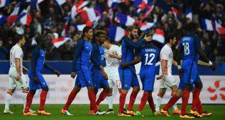 Francia supera su examen de seguridad y brilla Griezmann