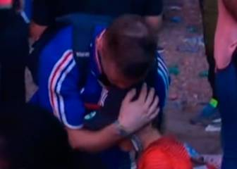 Portuguese boy consoles crying Frenchman with hug