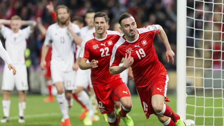 Swiss forward Josip Drmic (R) celebrates scoring the opening goal during the 2018 Fifa World Cup Russia group B qualification soccer match between Switzerland and Latvia, at the stade de Geneve stadium, in Geneva, Switzerland, 25 March 2017.