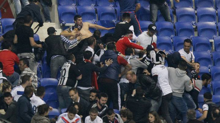 Besiktas and Lyon fans clash in the stands.