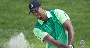 Tiger Woods no puede continuar por dolores en la espalda
