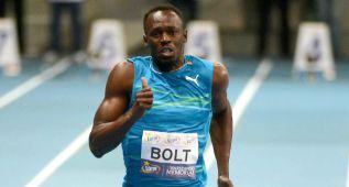 Bolt gana con 9.98, récord mundial... en pista cubierta