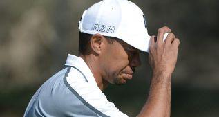 Tiger abandona en Torrey Pines por problemas de espalda
