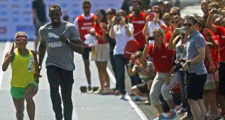 Bolt hace de guía de la atleta ciega más rápida del mundo