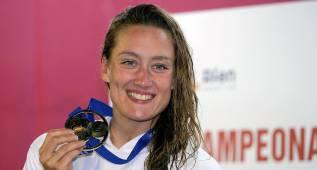 Mireia Belmonte gana su 5º oro al batir a Melani Costa