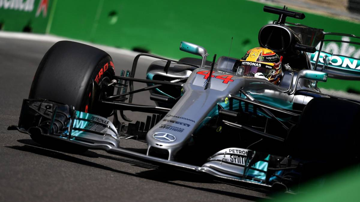 Rivals Hamilton, Vettel clash as Ricciardo wins chaotic race