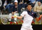 Djokovic sigue adelante tras sobrevivir a un gran Ferrer