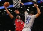 Bosh y Wade toman el control y derrotan a unos buenos Nets