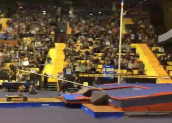 Surreal pole vault jump with the aid of a skateboard