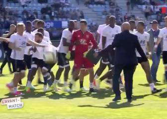 Lyon players attacked by pitch-invading Bastia fans