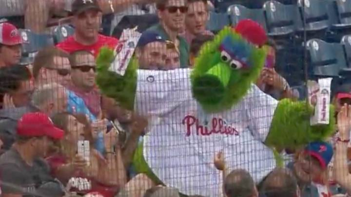 Phillie Phanatic: crazy baseball mascot covers fans in popcorn, knocks mobile phone to floor