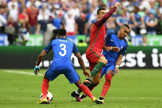 Payet crashes into Cristiano Ronaldo which effectively ended the tournament for the Real Madrid striker.