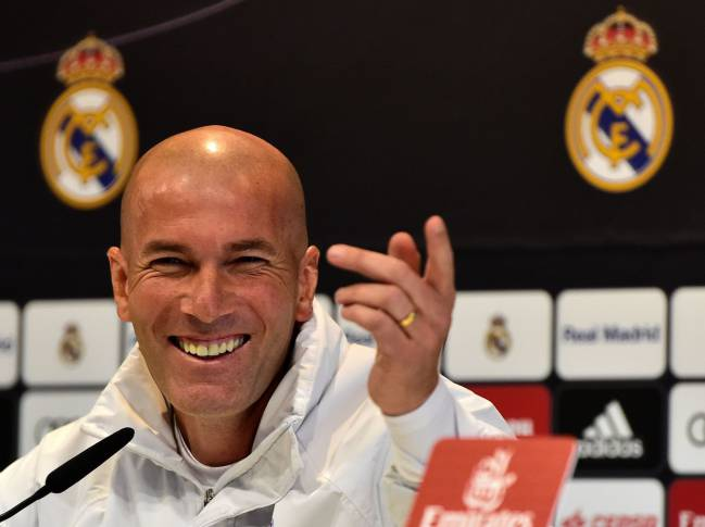 Real Madrid's French coach Zinedine Zidane smiles during a press conference on the eve of the Spanish Copa del Rey game vs Sevilla FC.