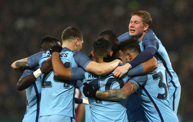Sergio Aguero of Manchester City celebrates with team mates after scoring his sides fourth goal during The Emirates FA Cup Third Round match