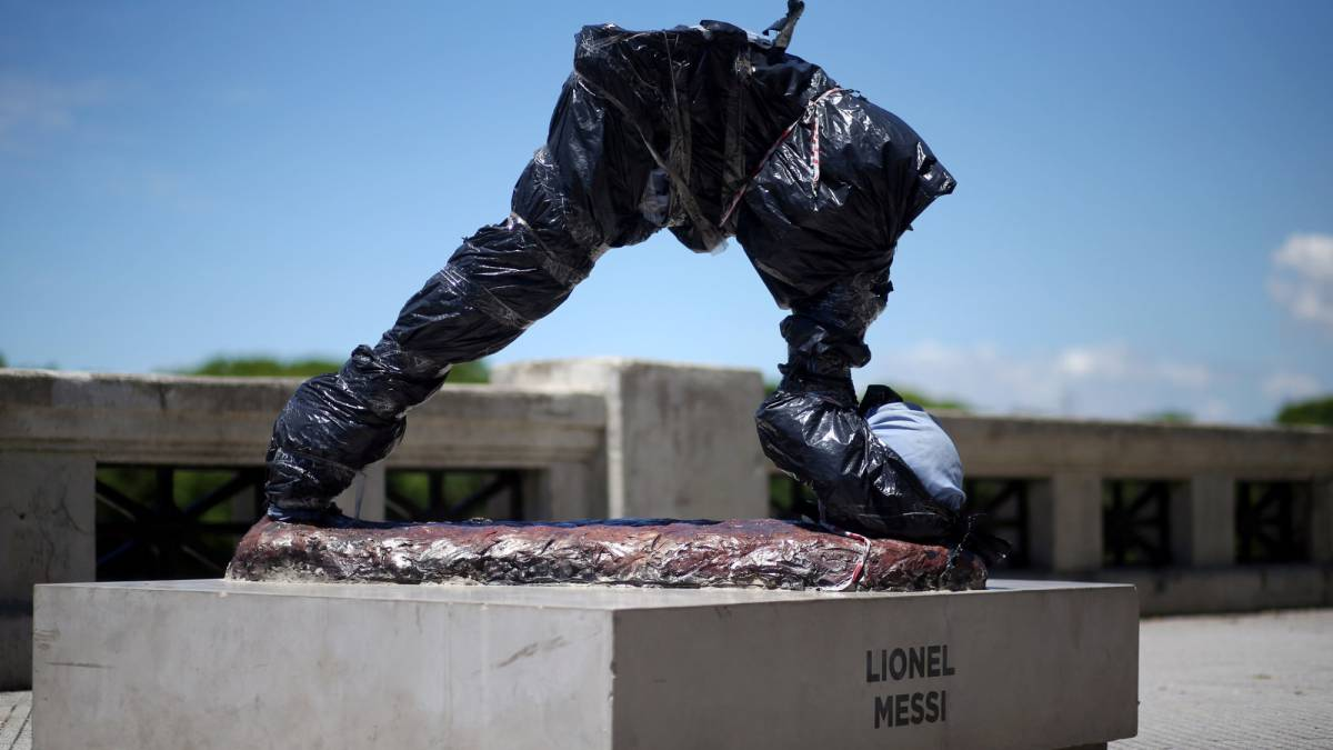 The statue of Argentina's soccer player Lionel Messi is seen covered after it was vandalized in Buenos Aires, Argentina