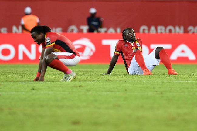 Uganda's midfielder Hassan Wasswa and Uganda's midfielder Geoffrey Kizito react at the end of the Ghana game.