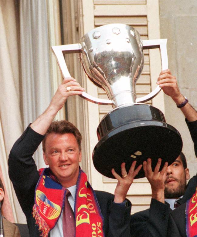 May 24, 1999: Barcelona's Dutch coach Louis Van Gaal lifts the League trophy with team captain Pep Guardiola.