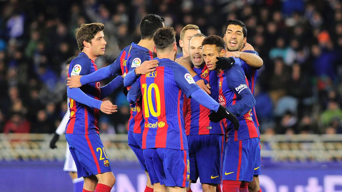 Barcelona's players celebrate after Brazilian forward Neymar scored his team's first goal during the Spanish Copa del Rey quarter final first leg football match Real Sociedad