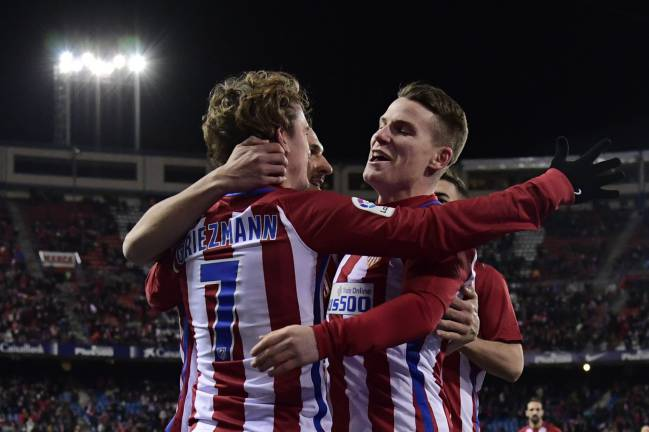 Kevin Gameiro and Antoine Griezmann celebrate after scoring against SD Eibar at the Vicente Calderon.