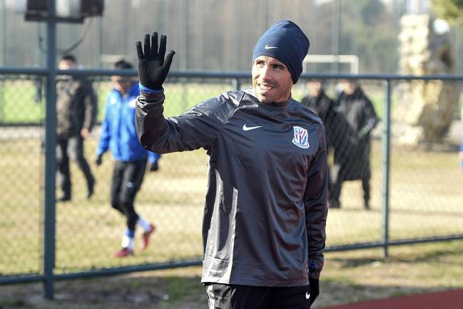 Carlos Tevez pictured in his first training session with Shanghai Shenhua.