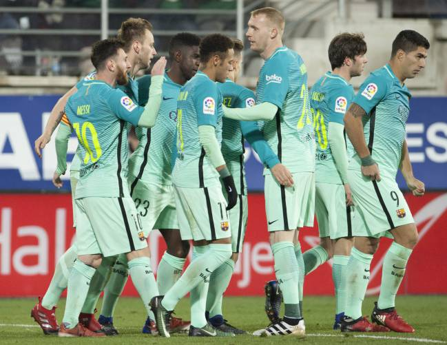 Barcelona celebrate scoring against Eibar.