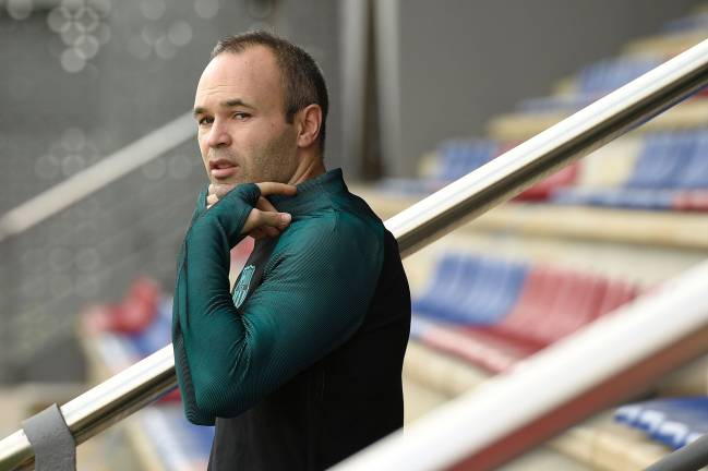 Barcelona's midfielder Andres Iniesta arrives for a training session at the Sports Center FC Barcelona