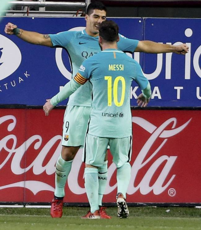 Lionel Messi and Luis Suarez celebrate a goal against Eibar on Sunday night