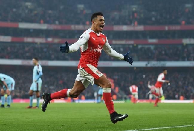 Alexis Sanchez of Arsenal celebrates scoring his team's second goal during the Premier League match between Arsenal and Burnley