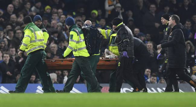 Hull City's Ryan Mason (C) is taken off the pitch by medical teams after a collision with Chelsea's Gary Cahill