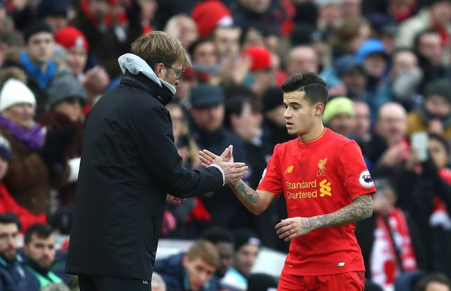Jurgen Klopp, Manager of Liverpool and Philippe Coutinho of Liverpool shake hands after he is subbed off during the Premier League match between Liverpool and Swansea City