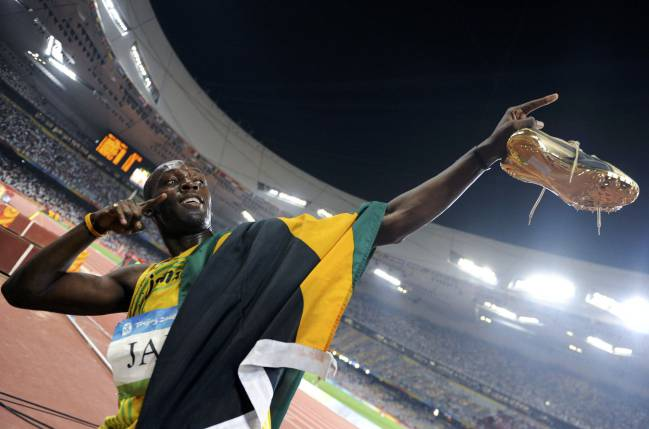 Usain Bolt of Jamaica celebrates after his team won the men's 4x100m relay athletics final